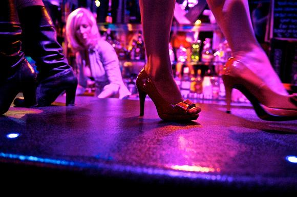 Dancing at the bar